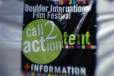 the outside of a white event tent is shown with the words Call2Action