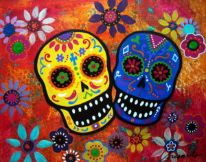 A bright mural depicting two skulls and many flowers
