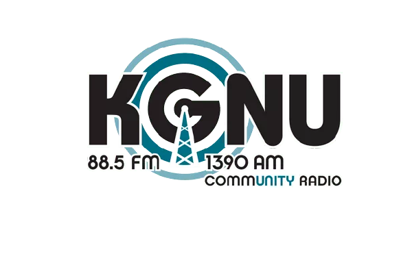 The KGNU logo displays the acronym in bold, rounded black letters. The G is surrounded by blue circles as if it is emitting radio waves.