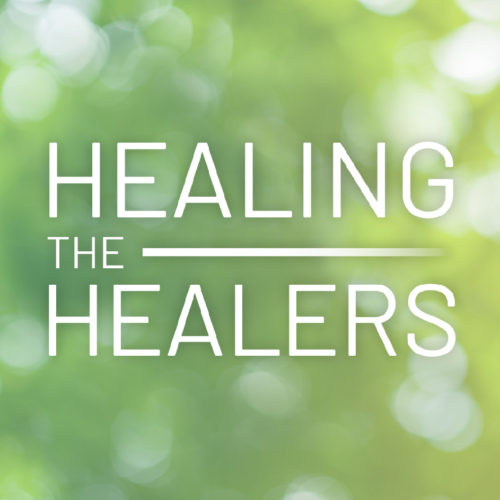 the healing the healers logo features all-caps thin white text on a green bokeh background.